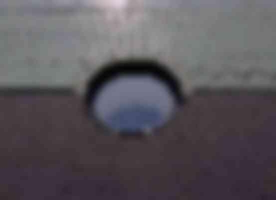 Detail van een rond raam in de kopgevel.